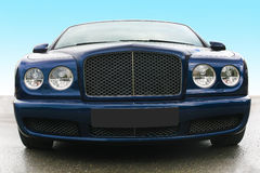 Prestige of car frontal. Blue prestige of car frontal on asphalt against the sky Royalty Free Stock Image