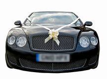 Prestige luxury wedding cars. Photo of a black high performance luxury wedding car with headlights off Stock Photos