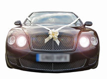 Prestige luxury wedding cars. Photo of a black luxurious high performance wedding car with headlights on Royalty Free Stock Photos