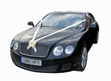 Prestige luxury wedding cars. Photo of gorgeous black luxurious wedding car with headlights off Royalty Free Stock Images