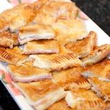 Presunto e queijo na pastelaria de sopro fotografia de stock royalty free