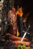 Presuntos defumados da carne de porco contra uma chaminé Imagens de Stock