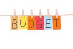 Presupuesto, caída colorida de las palabras en cuerda Imágenes de archivo libres de regalías