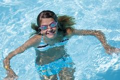 Preteen. Model Release 358 Preteen girl, enjoying a day at the swimming pool stock images