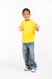 Preteen african boy. A happy african preteen boy in casual clothes posing on white background Stock Photo