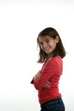 Preteen with arms crossed. A preteen girl standing sideways with arms crossed isolated on white background Stock Image