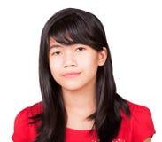 Preteen biracial dziewczyna w czerwonej koszula na białym tle Fotografia Stock