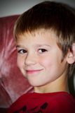 Preteen Boy. A closeup of a cute smiling young preteen boy. Shallow depth of field Stock Photo
