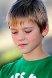 Preteen Boy. A closeup of a cute thoughtful young preteen boy. Shallow depth of field Royalty Free Stock Photos