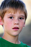 Preteen Boy. A closeup of a surprised thoughtful young preteen boy. Shallow depth of field Royalty Free Stock Photos