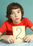 Preteen boy with bad mark 2 close up photo Stock Images