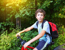 Preteen boy on bicycle hike close up portrait Stock Photos