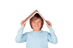 Preteen boy with a big book oh his head Stock Photos