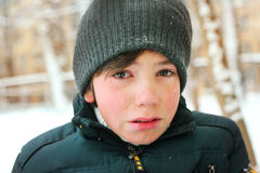 Preteen boy cry frustrated after tearing his jacket Royalty Free Stock Photo
