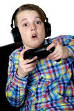 Preteen boy with an excited expression playing a video game hold Stock Photography