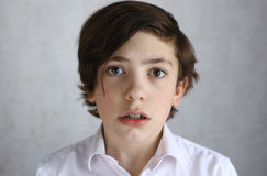 Preteen boy with fear afraid expression Royalty Free Stock Photo