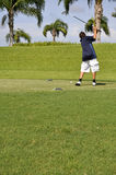 Preteen boy golfing Stock Photo