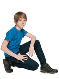 Preteen boy. A handsome preteen boy sits on the white background Royalty Free Stock Photos