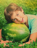 Preteen boy have siesta nap with water melon Royalty Free Stock Photo