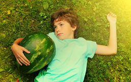 Preteen boy have siesta nap with water melon Royalty Free Stock Images