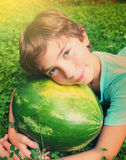 Preteen boy have siesta nap with water melon Royalty Free Stock Photos