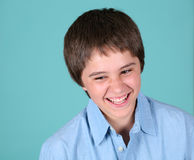 Preteen boy laughing Royalty Free Stock Images