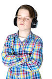 Preteen boy listening to music with headphones with eyes closed Stock Photo