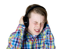 Preteen boy listening to music with headphones and an intense fa Royalty Free Stock Photo