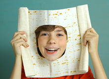 Preteen boy make fun cut hole in pita thin bread Royalty Free Stock Photography
