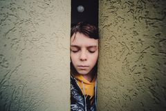 Preteen Boy On A Street In A Big City Next To A High-rise Building Alone. Stock Photo