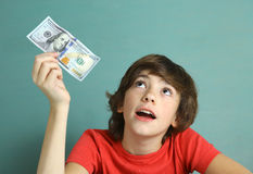 Preteen boy with one hundred dollar bill Stock Photo