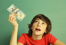 Preteen boy with one hundred dollar bill Royalty Free Stock Photography