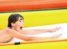 Preteen boy in open air aqua park Royalty Free Stock Images