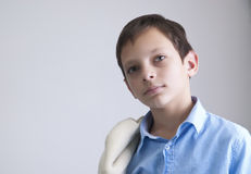 Preteen boy portrait on the grey background. Close up photo Stock Photos