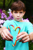 Preteen boy with rainbow candy sticks Stock Images