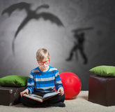 Preteen boy reading a book Royalty Free Stock Photography