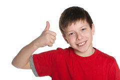 Preteen boy in the red shirt holds his thumb up Royalty Free Stock Images