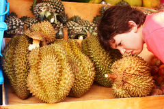 Preteen boy smell durian Royalty Free Stock Photo