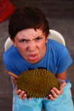 Preteen boy smell durian Royalty Free Stock Photos