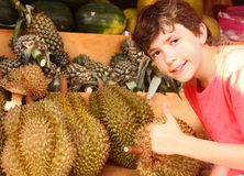 Preteen boy smell durian Royalty Free Stock Image