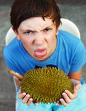 Preteen boy smell durian Stock Photo