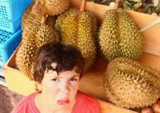 Preteen boy smell durian Royalty Free Stock Photography