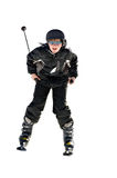Preteen Boy Snow Skiing. A preteen boy smiling as he goes downhill royalty free stock photos