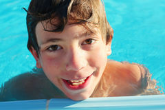Preteen boy in swimming pool close up photo Royalty Free Stock Photography
