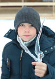 Preteen boy with tree branches in icicle Royalty Free Stock Image