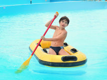 Preteen boy in water park in rubber boat Stock Photography