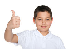 Preteen boy in the white shirt holds his thumb up Stock Images