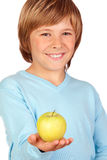 Preteen boy with a yellow apple Royalty Free Stock Image