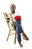 Preteen che si siede abbastanza in jeans Immagini Stock