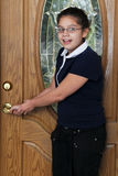 Preteen Checking the Door Lock Royalty Free Stock Photos
